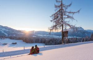 Ferienwohnung in den Kitzbüheler Horn romantischer Sonnenuntergang im Schnee wandern